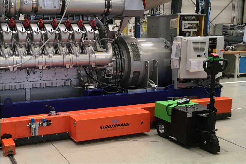 elektrický ručně vedený tahač t3500 ve výrobním podniku manipuluje těžký stroj na kolečkách