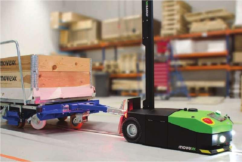 elektrický automaticky vedený tahač agv1000 se automaticky připojil ojí k vozíku s e-rámem a jede po vyznačené trase zásobovat výrobu, milkrun systém