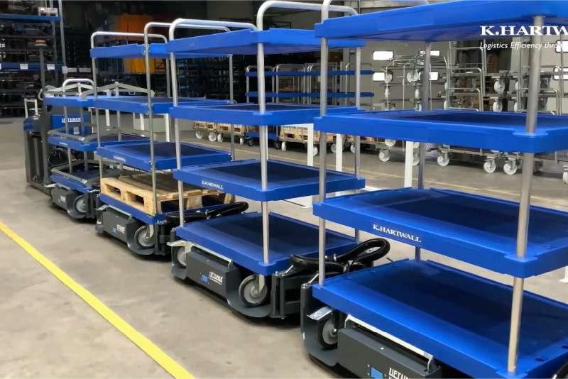 přepravní vozíky elephant board a tažná souprava liftliner pro zásobování výroby ve skladu od k.hartwall